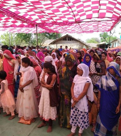 Women standing to get prayers